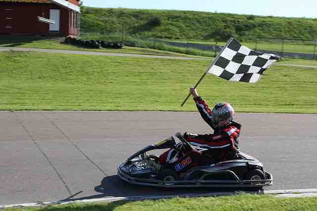 Go Kart Flag Carrying Driver