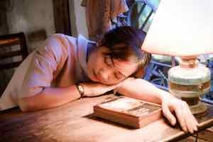 Asian Girl Sleeping On Desk-2