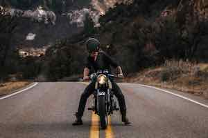 Man on motobike looking back